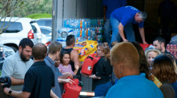 Health Insurance Innovations employees forming an assembly to load all the supplies onto the supply truck that will go to victims of Hurricane Michael