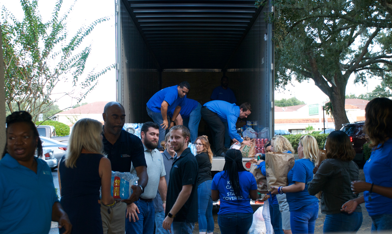 The supply truck being loaded by Health Insurance Innovations employees with supplies for victims of Hurricane Michael